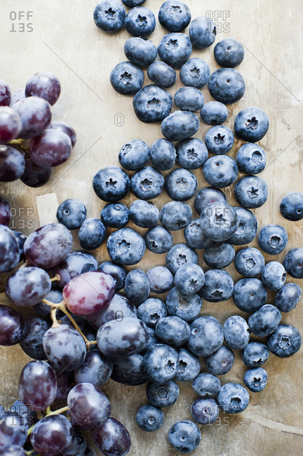Blueberries and a bunch of black grapes