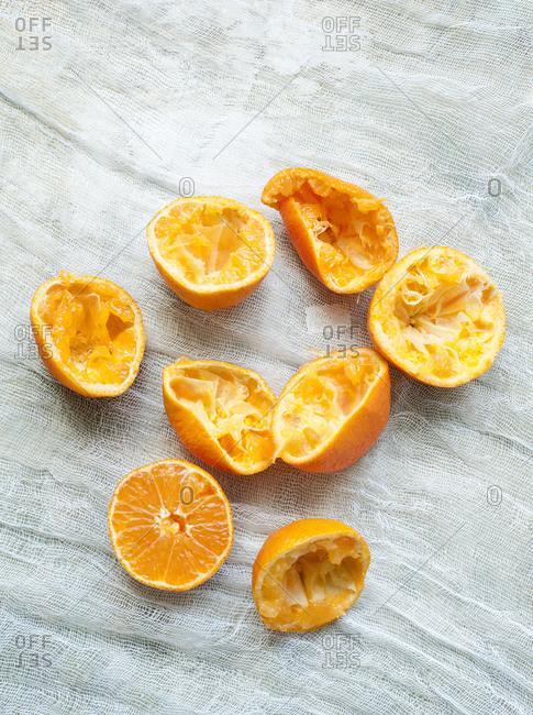 Freshly squeezed orange halves on muslin