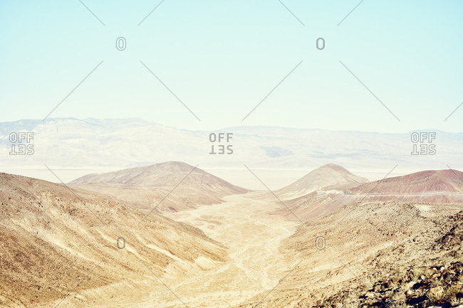 View of valley and distant mountains, Death Valley, California, USA