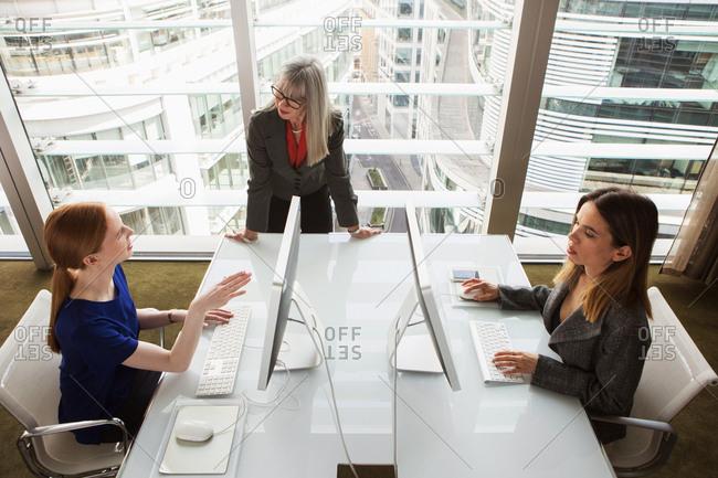 Mentor giving guidance to businesswomen, London, UK