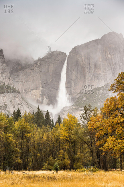Landscape with distant misty waterfall, Yosemite National Park, California, USA