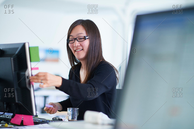 Businesswoman in office using computer
