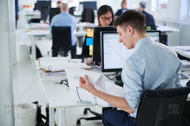 Colleagues working in office, using computer