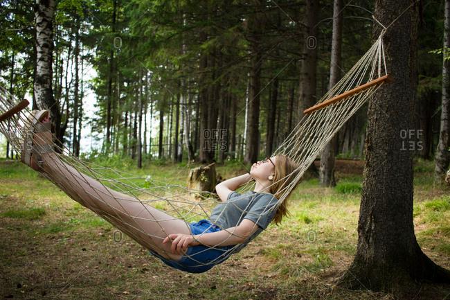 Woman resting in hammock, Nizny Tagil, Russia