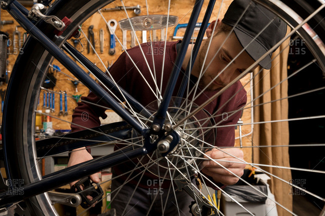 Technician in bicycle workshop