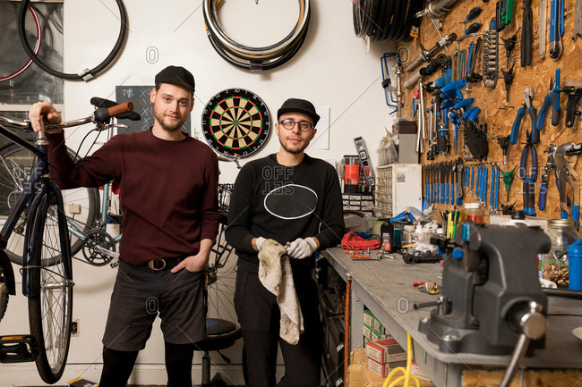 Technicians in bicycle workshop