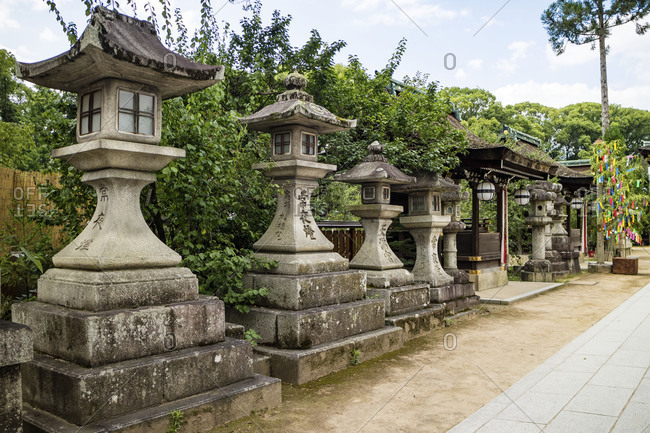 KYOTO, JAPAN - July 19, 2016: Row of stone lamp in Kitano tenmangu shrine, Kyoto