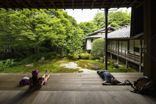 KYOTO, JAPAN - July 19, 2016: Tourists resting in Tofukuji buddhist temple in Kyoto, Japan