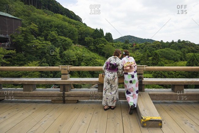 Young female tourists in Kimono at buddhist temple in eastern Kyoto