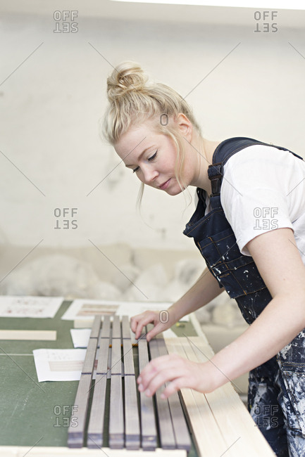 A craftperson works in her studio