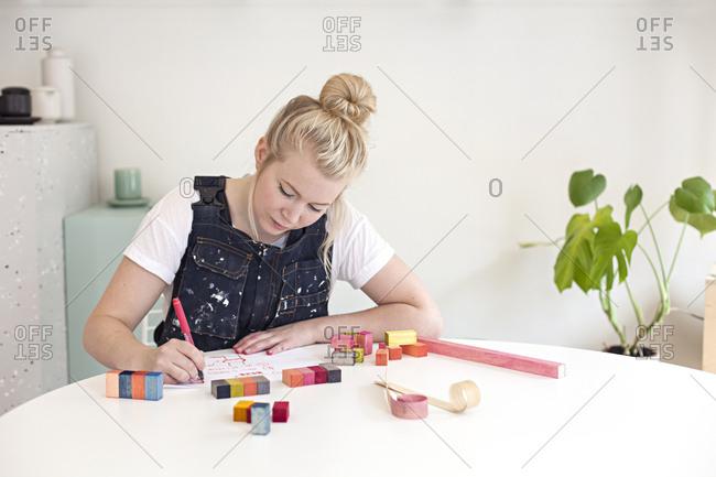 A designer works in her craft workshop
