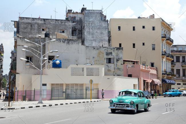 Havana, Cuba - May 22, 2017: Old car driving through street