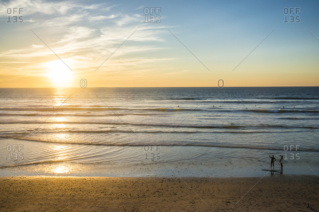 Couple in backlight walking at sunset, Del Mar, California, United States of America, North America