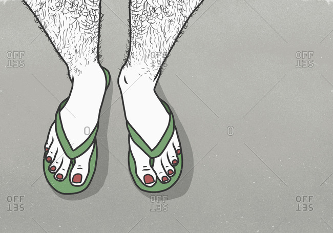 Low section of man with red nail polish wearing slippers over gray background