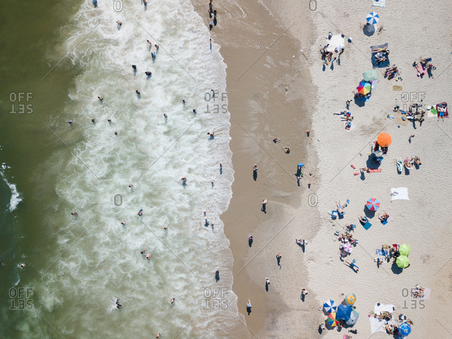 Beachgoers in the surf on a sandy beach