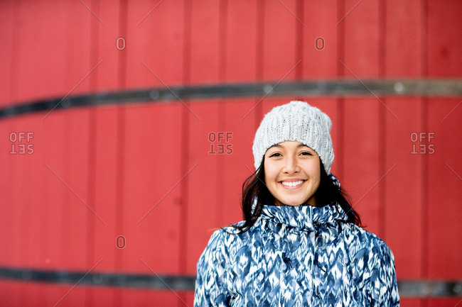 Portrait of a smiling woman wearing a knit hat