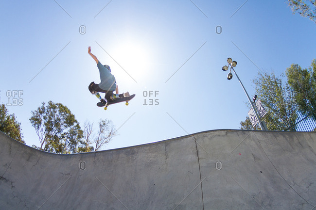 California, USA - August 17, 2014: Boy does tricks at a skatepark