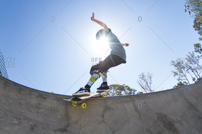 California, USA - August 17, 2014: Boy practices at a skatepark