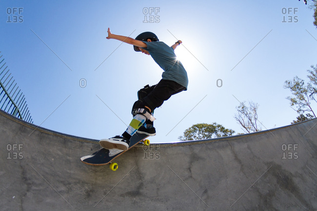 California, USA - August 17, 2014: Boy rides the bowl at a skatepark