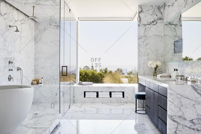 Los Angeles, California, USA - June 19, 2017: Modern bathroom with large window overlooking city