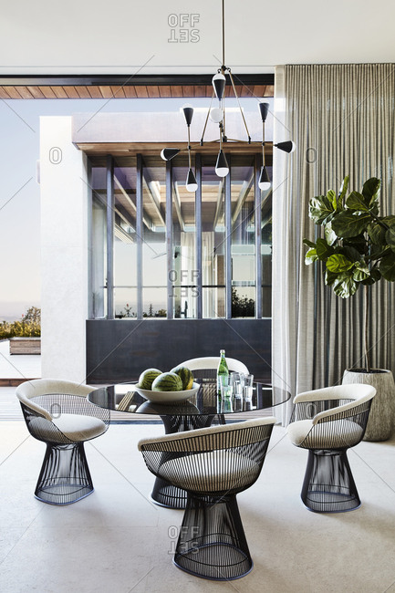 Los Angeles, California, USA - April 15, 2015: Modern dining table inside home in Hollywood Hills