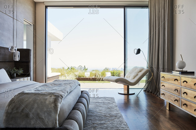Los Angeles, California, USA - June 19, 2017: Modern bedroom with large window overlooking city