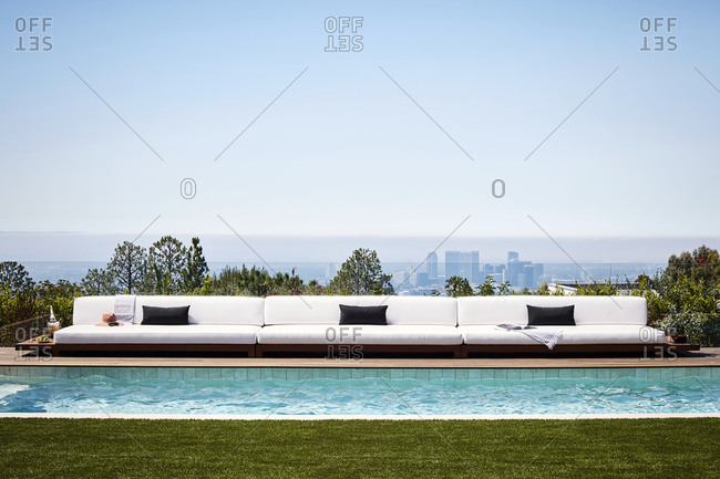 Los Angeles, California, USA - April 15, 2015: Outdoor swimming pool with view of the city