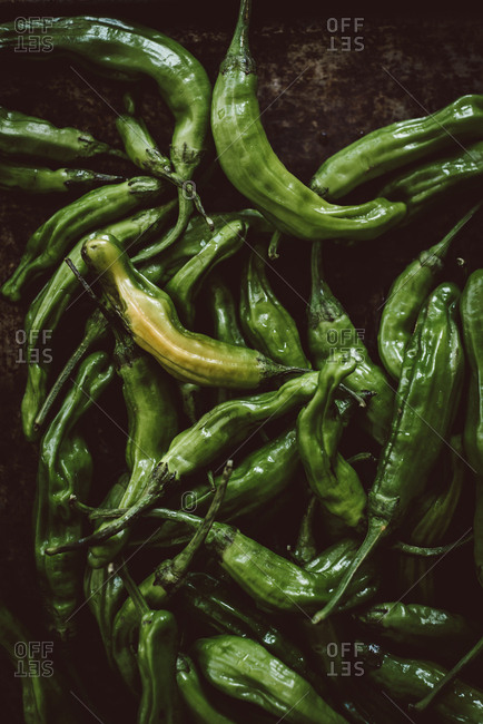 Green peppers on a dark background