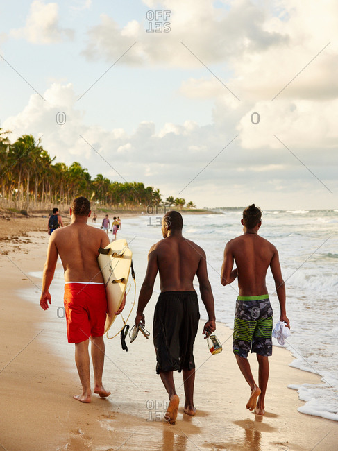 January 9, 2016 - Macao Beach, Dominican Republic: Three men walking together on beach