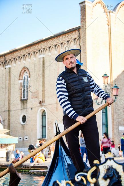 April 29, 2016 - Venice, Italy: Gondolier paddling boat