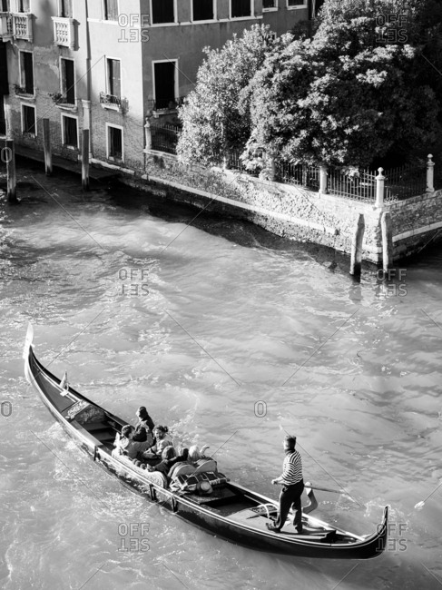 April 29, 2016 - Venice, Italy: Gondolier taking tourists on boat ride