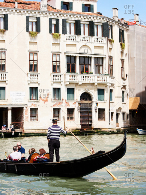 April 30, 2016 - Venice, Italy: Tourists riding  gondola in canals