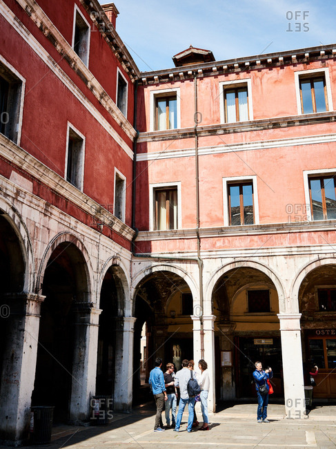 April 30, 2016 - Venice, Italy: Friends meeting in street