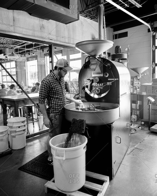 Birmingham, Alabama - July 10, 2015: Man working at coffee roaster