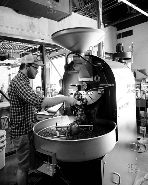 Birmingham, Alabama - July 10, 2015: Man working with coffee roaster