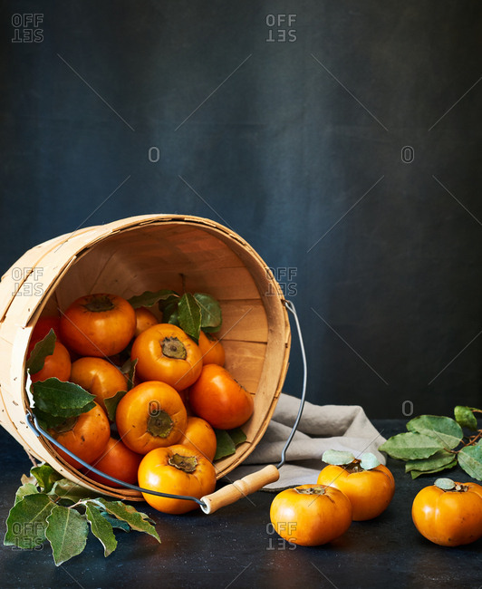 Still life of persimmons in a basket