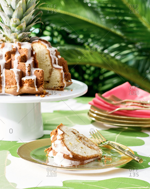Slice of tropical bundt cake on plate