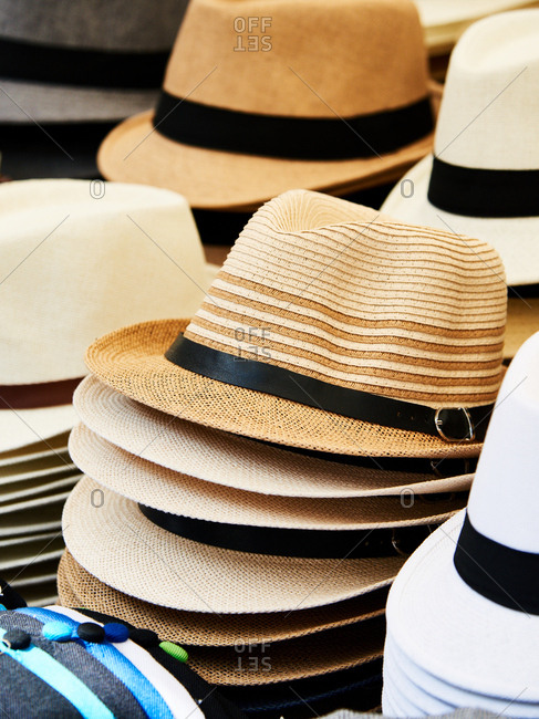 Woven straw hats for sale in market