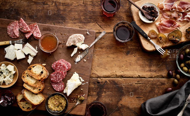 Charcuterie snacks on wood background