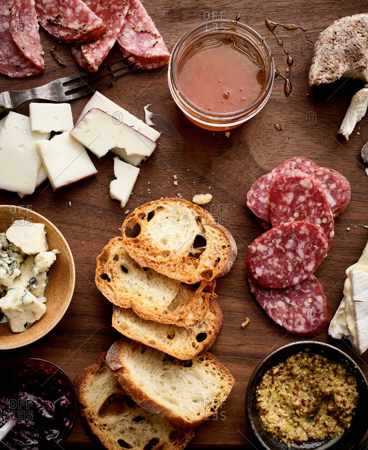 Meats and cheese on wood background