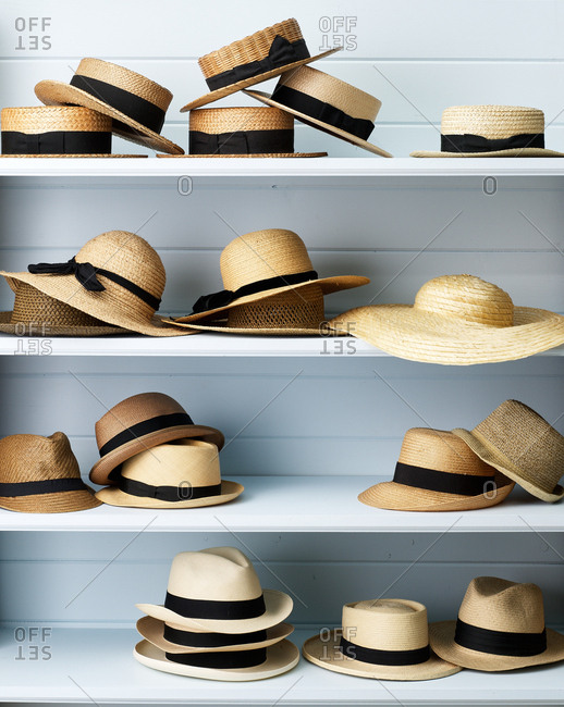 Straw hats on shelves