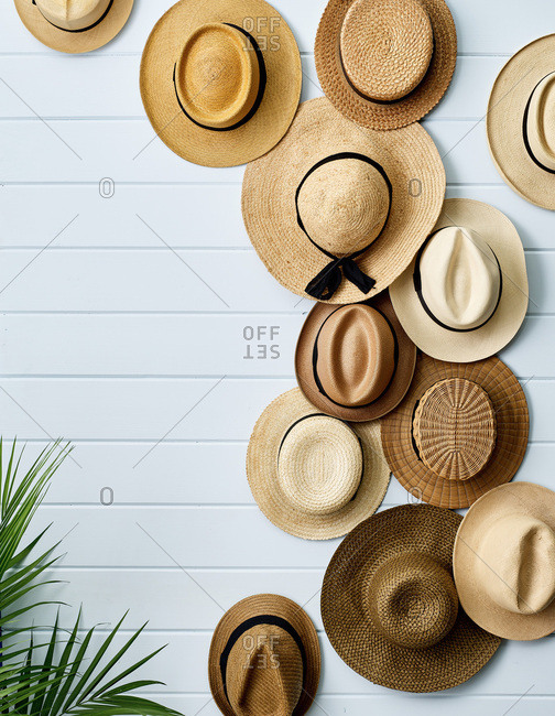 Straw hats decorating a wall