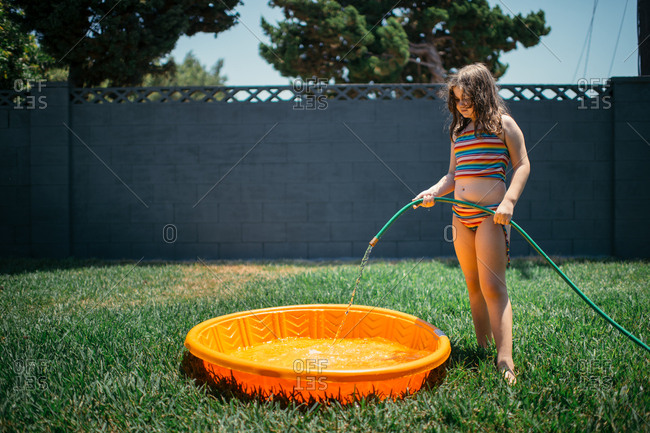 Filling Children S Plastic Pool With A Garden Hose