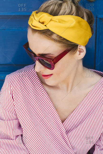 High angle view of woman in headband and sunglasses