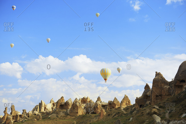 Low angle view of hot air balloons over Cappadocia