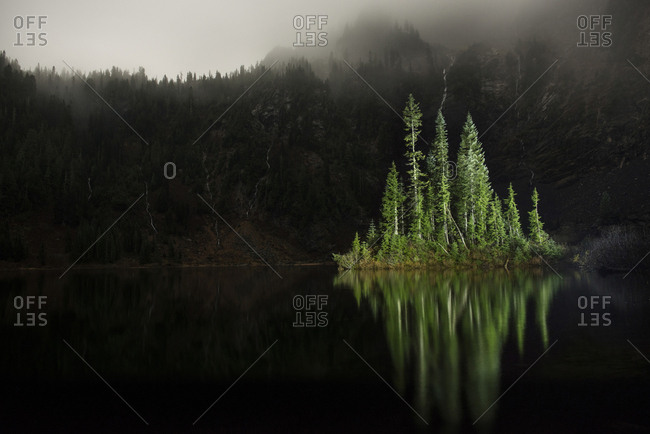 Scenic view of trees by lake at Cascade National Park during dusk