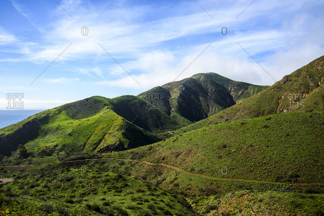 Scenic view of hills against sky