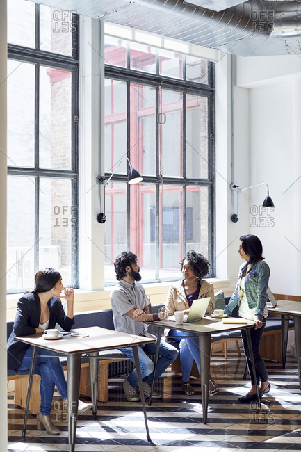 Business people having discussion during meeting in office cafeteria