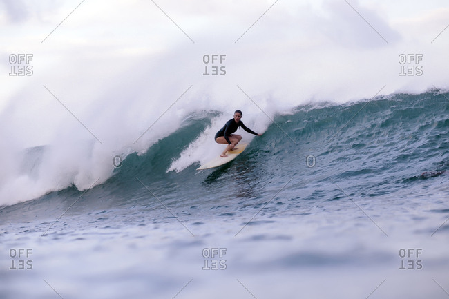 Full length of woman surfing in sea
