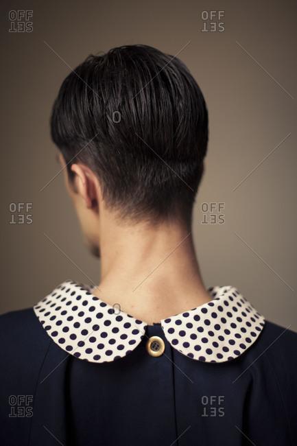 Back of man in a puritan collar top